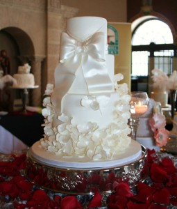 A gorgeous cake complete with satin inspired sugar bow and delicate flowers