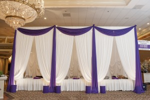 Our Elegant Event Lighting team designed this gorgeous drape entrance!